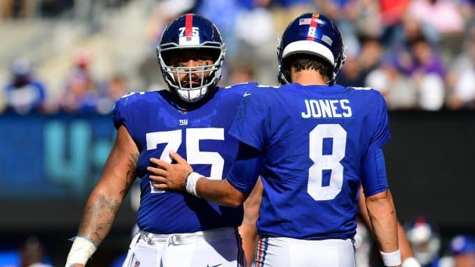 EAST RUTHERFORD, NEW JERSEY - SEPTEMBER 29: Daniel Jones #8 and Jon Halapio #75 of the New York Giants communicate during their game against the Washington Redskins at MetLife Stadium on September 29, 2019 in East Rutherford, New Jersey.