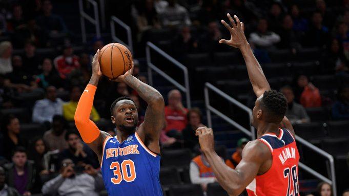 New York Knicks forward Julius Randle (30) shoots next to Washington Wizards center Ian Mahinmi (28) during the first half of an NBA basketball game, Saturday, Dec. 28, 2019, in Washington.