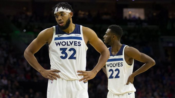 PHILADELPHIA, PA - OCTOBER 30: Karl-Anthony Towns #32 and Andrew Wiggins #22 of the Minnesota Timberwolves look on against the Philadelphia 76ers at the Wells Fargo Center on October 30, 2019 in Philadelphia, Pennsylvania. NOTE TO USER: User expressly acknowledges and agrees that, by downloading and or using this photograph, User is consenting to the terms and conditions of the Getty Images License Agreement.