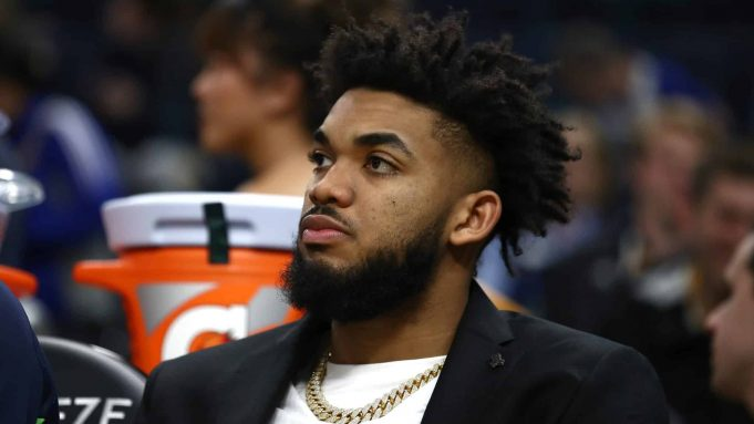 SAN FRANCISCO, CALIFORNIA - DECEMBER 23: Injured Karl-Anthony Towns #32 of the Minnesota Timberwolves watches his team play against the Golden State Warriors at Chase Center on December 23, 2019 in San Francisco, California. NOTE TO USER: User expressly acknowledges and agrees that, by downloading and/or using this photograph, user is consenting to the terms and conditions of the Getty Images License Agreement.