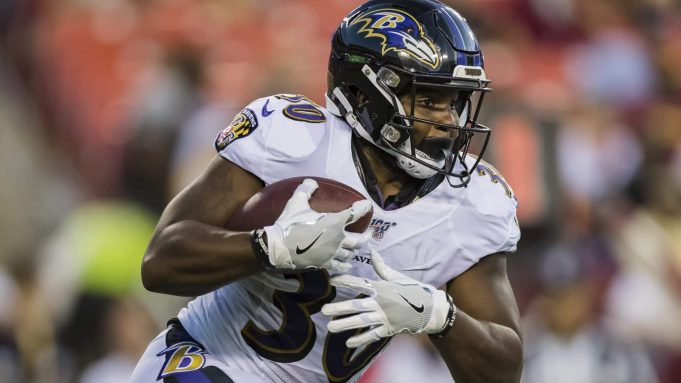 LANDOVER, MD - AUGUST 29: Kenneth Dixon #30 of the Baltimore Ravens carries the ball during the first half of a preseason game against the Washington Redskins at FedExField on August 29, 2019 in Landover, Maryland.