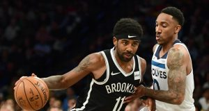 NEW YORK, NEW YORK - OCTOBER 23: Jeff Teague #0 of the Minnesota Timberwolves guards Kyrie Irving #11 of the Brooklyn Nets as he dribbles the ball during the first half of their game at Barclays Center on October 23, 2019 in the Brooklyn borough of New York City. NOTE TO USER: User expressly acknowledges and agrees that, by downloading and or using this photograph, User is consenting to the terms and conditions of the Getty Images License Agreement.
