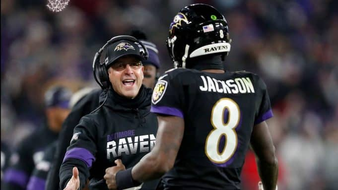 BALTIMORE, MARYLAND - DECEMBER 12: Head coach John Harbaugh of the Baltimore Ravens and quarterback Lamar Jackson #8 celebrate a touchdown in the third quarter of the game against the New York Jets at M&T Bank Stadium on December 12, 2019 in Baltimore, Maryland.