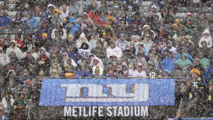 EAST RUTHERFORD, NEW JERSEY - DECEMBER 01: Fans endure bad weather during the New York Giants and the Green Bay Packers game at MetLife Stadium on December 01, 2019 in East Rutherford, New Jersey.