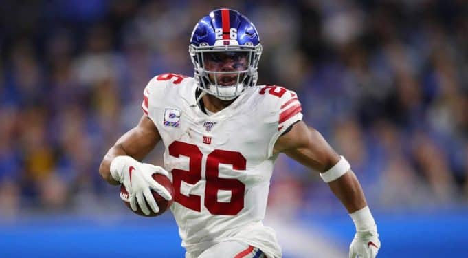 DETROIT, MICHIGAN - OCTOBER 27: Saquon Barkley #26 of the New York Giants looks for running room against the Detroit Lions in the first half at Ford Field on October 27, 2019 in Detroit, Michigan.