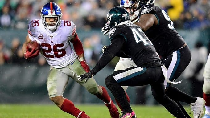 PHILADELPHIA, PENNSYLVANIA - DECEMBER 09: Running back Saquon Barkley #26 of the New York Giants carries the ball against the defense of the Philadelphia Eagles during the game at Lincoln Financial Field on December 09, 2019 in Philadelphia, Pennsylvania.