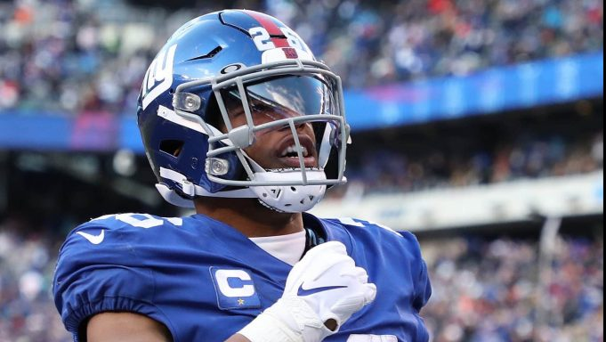 EAST RUTHERFORD, NEW JERSEY - DECEMBER 15: Saquon Barkley #26 of the New York Giants celebrates his touchdown in the third quarter against the Miami dolphins during their game at MetLife Stadium on December 15, 2019 in East Rutherford, New Jersey.
