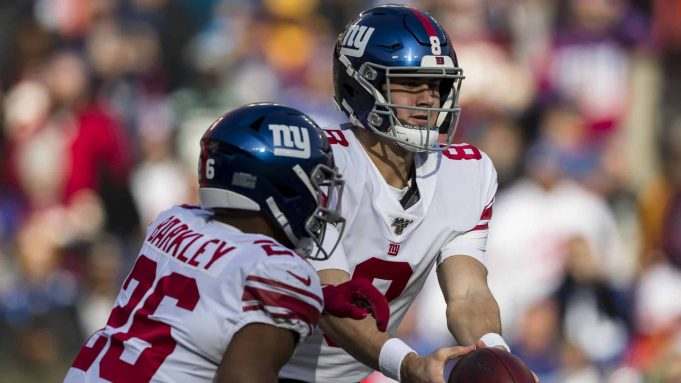LANDOVER, MD - DECEMBER 22: Daniel Jones #8 of the New York Giants hands the ball off to Saquon Barkley #26 during the first half of the game against the Washington Redskins at FedExField on December 22, 2019 in Landover, Maryland.