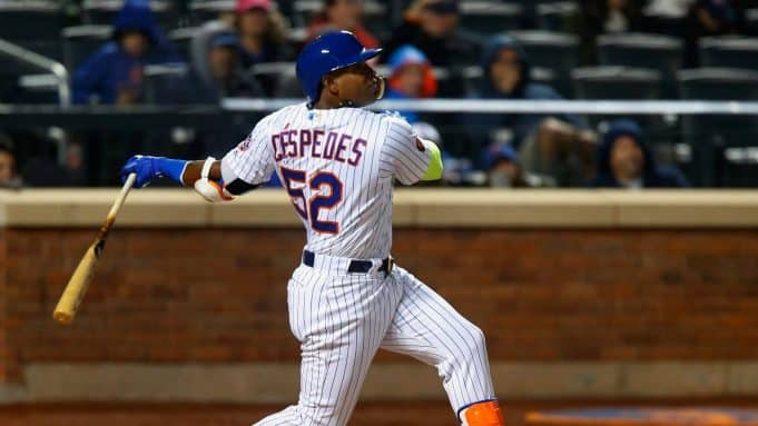 NEW YORK, NY - APRIL 14: Yoenis Cespedes #52 of the New York Mets follows through on a sixth inning RBI single against the Milwaukee Brewers at Citi Field on April 14, 2018 in the Flushing neighborhood of the Queens borough of New York City.