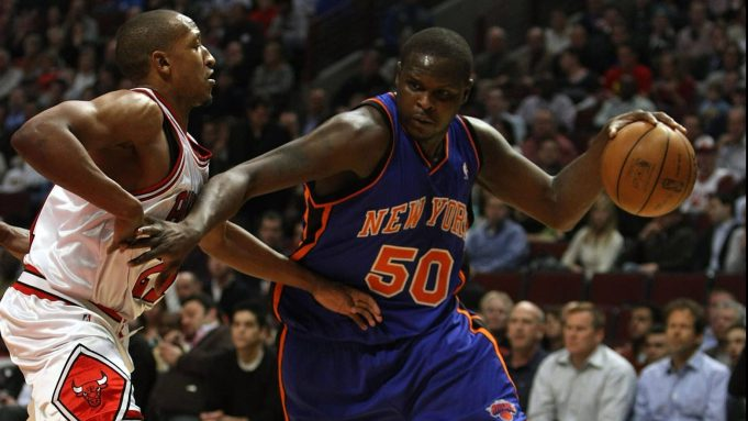 CHICAGO - JANUARY 08: Zach Randolph #50 of the New York Knicks drives around Chris Duhon #21 of the Chicago Bulls on January 8, 2008 at the United Center in Chicago, Illinois. NOTE TO USER: User expressly acknowledges and agreees that, by downloading and/or using this Photograph, User is consenting to the terms and conditions of the Getty Images License Agreement.