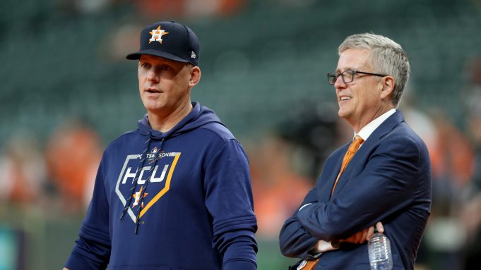 HOUSTON, TEXAS - OCTOBER 05: Manager AJ Hinch #14 talks with Jeff Luhnow, General Manager of the Houston Astros, prior to game two of the American League Division Series against the Tampa Bay Rays at Minute Maid Park on October 05, 2019 in Houston, Texas.
