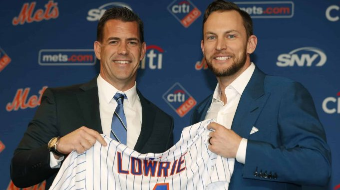 FILE - In this Jan. 16, 2019, file photo, New York Mets general manager Brodie Van Wagenen, left, poses for a photograph with new infielder Jed Lowrie during a baseball news conference in New York.