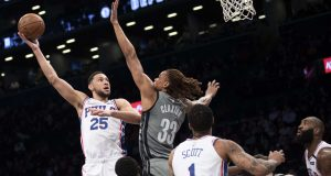 Philadelphia 76ers guard Ben Simmons (25) goes to the basket against Brooklyn Nets forward Nicolas Claxton (33) during the first half of an NBA basketball game, Monday, Jan. 20, 2020, in New York.