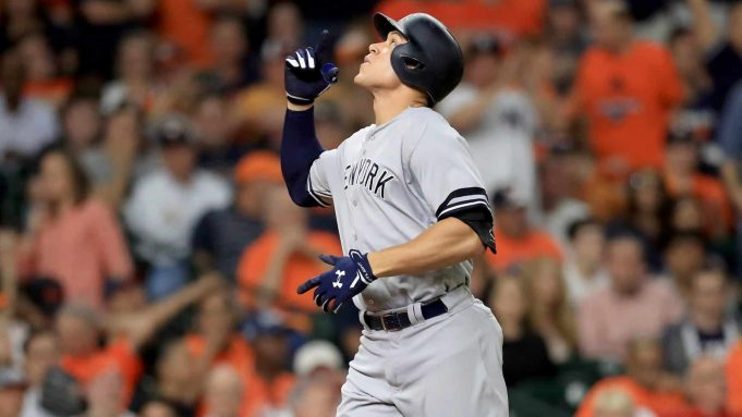 HOUSTON, TX - OCTOBER 20: Aaron Judge #99 of the New York Yankees celebrates after hitting a solo home run against Brad Peacock #41 of the Houston Astros during the eighth inning in Game Six of the American League Championship Series at Minute Maid Park on October 20, 2017 in Houston, Texas.