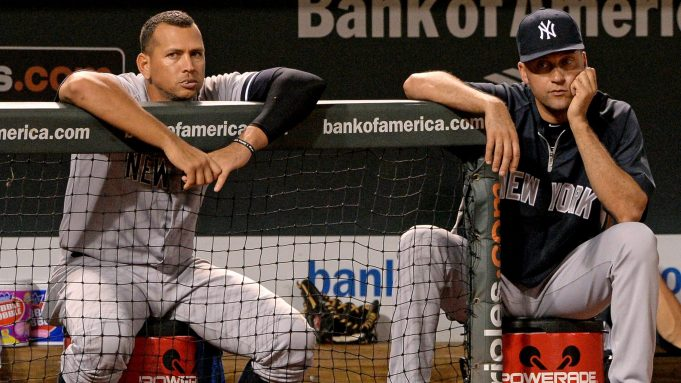 BALTIMORE, MD - SEPTEMBER 11: Alex Rodriguez #13 (L) and Derek Jeter #2 of the New York Yankees look on against the Baltimore Orioles in the ninth inning at Oriole Park at Camden Yards on September 11, 2013 in Baltimore, Maryland.