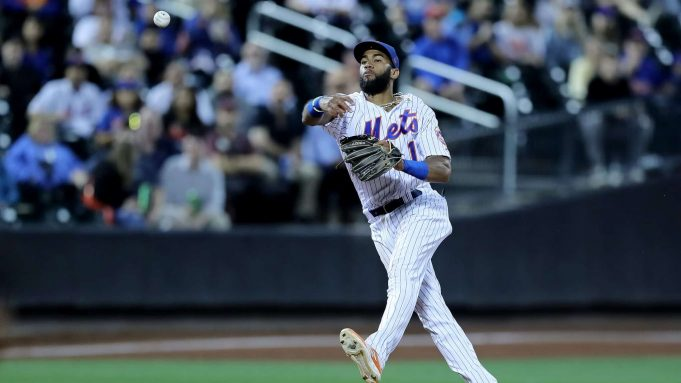 NEW YORK, NEW YORK - SEPTEMBER 24: Amed Rosario #1 of the New York Mets sends the ball to first for the out on a hit by Miguel Rojas of hte Miami Marlins in the fourth inning at Citi Field on September 24, 2019 in the Flushing neighborhood of the Queens borough of New York City.