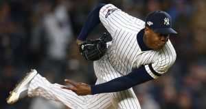 NEW YORK, NEW YORK - OCTOBER 18: Aroldis Chapman #54 of the New York Yankees throws a pitch against the Houston Astros during the ninth inning in game five of the American League Championship Series at Yankee Stadium on October 18, 2019 in New York City.