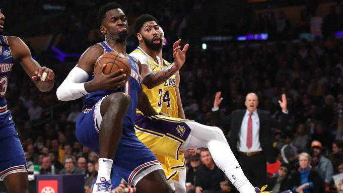 LOS ANGELES, CALIFORNIA - JANUARY 07: Bobby Portis #1 of the New York Knicks rebounds past Anthony Davis #3 of the Los Angeles Lakers during the first half of a game at Staples Center on January 07, 2020 in Los Angeles, California.