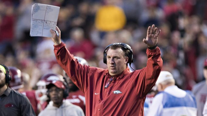 FAYETTEVILLE, AR - NOVEMBER 24: Head Coach Bret Bielema of the Arkansas Razorbacks signals to the officials during a game against the Missouri Tigers at Razorback Stadium on November 24, 2017 in Fayetteville, Arkansas. The Tigers defeated the Razorbacks 48-45.