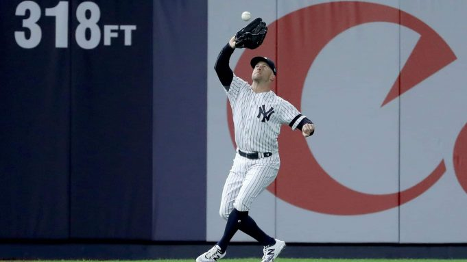 NEW YORK, NEW YORK - OCTOBER 18: Brett Gardner #11 of the New York Yankees catches a pop-up fly hit by Josh Reddick #22 of the Houston Astros during the seventh inning in game five of the American League Championship Series at Yankee Stadium on October 18, 2019 in New York City.