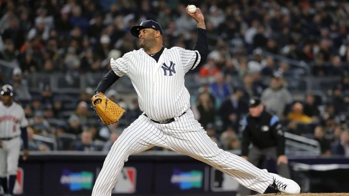 NEW YORK, NEW YORK - OCTOBER 17: CC Sabathia #52 of the New York Yankees delivers the pitch against the Houston Astros during the eighth inning in game four of the American League Championship Series at Yankee Stadium on October 17, 2019 in New York City.