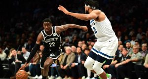 NEW YORK, NEW YORK - OCTOBER 23: Karl-Anthony Towns #32 of the Minnesota Timberwolves guards Caris LeVert #22 of the Brooklyn Nets as he dribbles the ball during the first half of their game at Barclays Center on October 23, 2019 in the Brooklyn borough of New York City. NOTE TO USER: User expressly acknowledges and agrees that, by downloading and or using this photograph, User is consenting to the terms and conditions of the Getty Images License Agreement.
