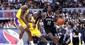 SHENZHEN, CHINA - OCTOBER 12: Caris LeVert #22 of the Brooklyn Nets in action during the match against Rajon Rondo #9 and Dwight Howard #39 of the Los Angeles Lakers during a preseason game as part of 2019 NBA Global Games China at Shenzhen Universiade Center on October 12, 2019 in Shenzhen, Guangdong, China.