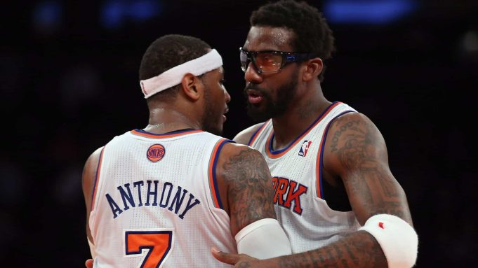 NEW YORK, NY - DECEMBER 11: Amar'e Stoudemire #1 and Carmelo Anthony #7 of the New York Knicks embrance following their victory over the Chicago Bulls at Madison Square Garden on December 11, 2013 in New York City. The Knicks defeated the Bulls 83-78.