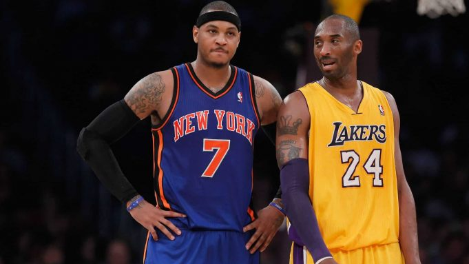 LOS ANGELES, CA - DECEMBER 29: Carmelo Anthony #7 of the New York Knicks and Kobe Bryant #24 of the Los Angeles Lakers talk during the first half at Staples Center on December 29, 2011 in Los Angeles, California. NOTE TO USER: User expressly acknowledges and agrees that, by downloading and or using this photograph, User is consenting to the terms and conditions of the Getty Images License Agreement.
