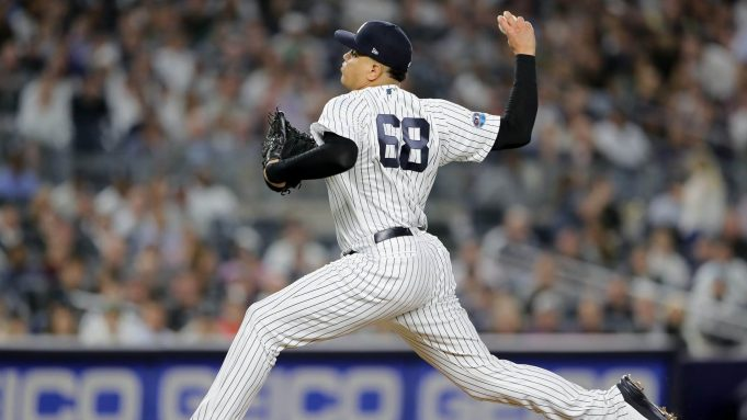 NEW YORK, NEW YORK - OCTOBER 03: Dellin Betances #68 of the New York Yankees throws a pitch against the Oakland Athletics during the fifth inning in the American League Wild Card Game at Yankee Stadium on October 03, 2018 in the Bronx borough of New York City.