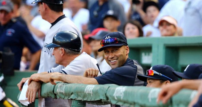 BOSTON, MA - SEPTEMBER 28: Derek Jeter #2 of the New York Yankees looks on from the dugout against the Boston Red Sox during the last game of the season at Fenway Park on September 28, 2014 in Boston, Massachusetts.