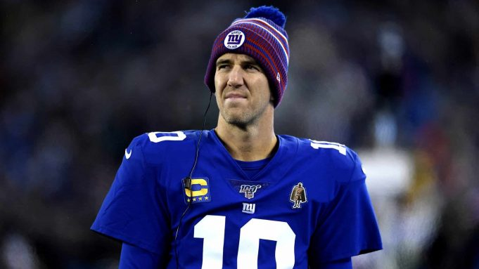 EAST RUTHERFORD, NEW JERSEY - DECEMBER 29: Eli Manning #10 of the New York Giants looks on from the sidelines against the Philadelphia Eagles during the first quarter in the game at MetLife Stadium on December 29, 2019 in East Rutherford, New Jersey.