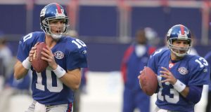 EAST RUTHERFORD, NJ - NOVEMBER 21: Eli Manning #10 and Kurt Warner #13 of the New York Giants drop back to pass during warm ups before their game against the Atlanta Falcons at Giant Stadium on November 21, 2004 in East Rutherford, New Jersey.