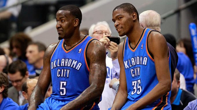 DALLAS, TX - MAY 19: Kendrick Perkins #5 and Kevin Durant #35 of the Oklahoma City Thunder wait to enter the game in the third quarter while taking on the Dallas Mavericks in Game Two of the Western Conference Finals during the 2011 NBA Playoffs at American Airlines Center on May 19, 2011 in Dallas, Texas. NOTE TO USER: User expressly acknowledges and agrees that, by downloading and or using this photograph, User is consenting to the terms and conditions of the Getty Images License Agreement.