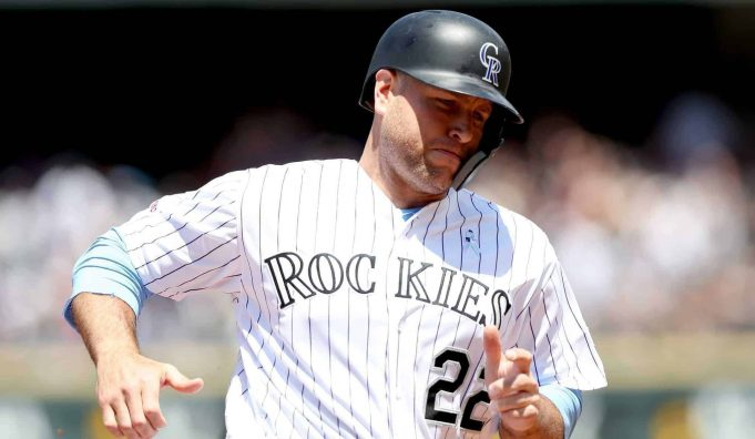 DENVER, COLORADO - JUNE 16: Chris Iannetta #22 of the Colorado Rockies rounds third base to score on a fielding error on a hit by Charlie Blackmon in the first inning against the San Diego Padres at Coors Field on June 16, 2019 in Denver, Colorado.