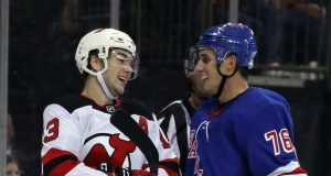 NEW YORK, NEW YORK - SEPTEMBER 18: Nico Hischier #13 of the New Jersey Devils nd Brady Skjei #76 of the New York Rangers exchange a laugh during the third period at Madison Square Garden on September 18, 2019 in New York City. The Devils defeated the Rangers 4-3.