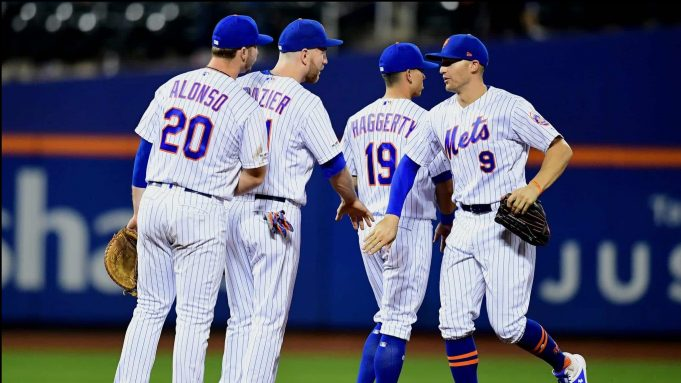 NEW YORK, NEW YORK - SEPTEMBER 25: Brandon Nimmo #9 high fives Sam Haggerty #19, Todd Frazier #21, and Pete Alonso #20 of the New York Mets after their 10-3 win over the Miami Marlins at Citi Field on September 25, 2019 in the Flushing neighborhood of the Queens borough in New York City.
