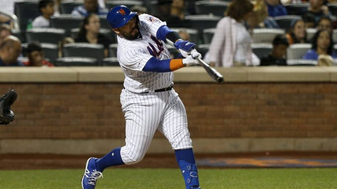NEW YORK, NEW YORK - SEPTEMBER 28: Rene Rivera #44 of the New York Mets connects on a third inning two run home run against the Atlanta Braves at Citi Field on September 28, 2019 in New York City.