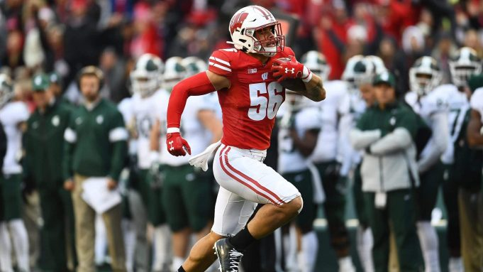 MADISON, WISCONSIN - OCTOBER 12: Zack Baun #56 of the Wisconsin Badgers returns an interception for a touchdown during the second half of a game against the Michigan State Spartans at Camp Randall Stadium on October 12, 2019 in Madison, Wisconsin.