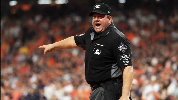 HOUSTON, TEXAS - OCTOBER 29: umpire Sam Holbrook #34 reacts after making a runner interface call on Trea Turner (not pictured) of the Washington Nationals during the seventh inning in Game Six of the 2019 World Series between the Houston Astros and the Washington Nationals at Minute Maid Park on October 29, 2019 in Houston, Texas.