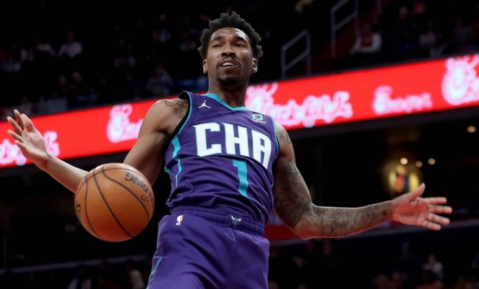 WASHINGTON, DC - NOVEMBER 22: Malik Monk #1 of the Charlotte Hornets dunks the ball against the Washington Wizards in the first half at Capital One Arena on November 22, 2019 in Washington, DC. NOTE TO USER: User expressly acknowledges and agrees that, by downloading and/or using this photograph, user is consenting to the terms and conditions of the Getty Images License Agreement.