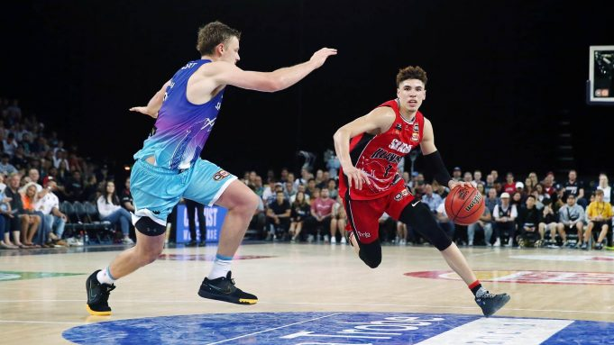 AUCKLAND, NEW ZEALAND - NOVEMBER 30: LaMelo Ball of the Hawks drives against Finn Delany of the Breakers during the round 9 NBL match between the New Zealand Breakers and the Illawarra Hawks at Spark Arena on November 30, 2019 in Auckland, New Zealand.
