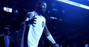 NEW YORK, NEW YORK - JANUARY 12: Kyrie Irving #11 of the Brooklyn Nets is introduced prior to the game against the Atlanta Hawks at Barclays Center on January 12, 2020 in New York City.