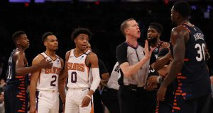 NEW YORK, NEW YORK - JANUARY 16: Frank Ntilikina #11 of the New York Knicks holds back Elie Okobo #2 of the Phoenix Suns as the referee tries to calm Julius Randle #30 of the New York Knicks aftr the game at Madison Square Garden on January 16, 2020 in New York City.The Phoenix Suns defeated the New York Knicks 121-98.NOTE TO USER: User expressly acknowledges and agrees that, by downloading and or using this photograph, User is consenting to the terms and conditions of the Getty Images License Agreement.
