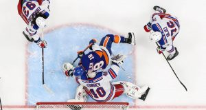UNIONDALE, NEW YORK - JANUARY 16: Anthony Beauvillier #18 of the New York Islanders skates in on Alexandar Georgiev #40 of the New York Rangers at NYCB Live's Nassau Coliseum on January 16, 2020 in Uniondale, New York. The Rangers defeated the Islanders 2-1.