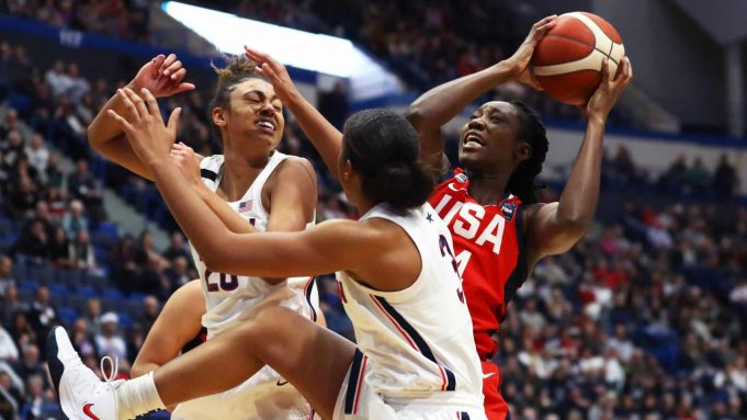 HARTFORD, CONNECTICUT - JANUARY 27: Tina Charles #14 of the United States looks for a shot over Megan Walker #3 and Olivia Nelson-Ododa #20 of the UConn Huskies during USA Women's National Team Winter Tour 2020 game between the United States and the UConn Huskies at The XL Center on January 27, 2020 in Hartford, Connecticut.