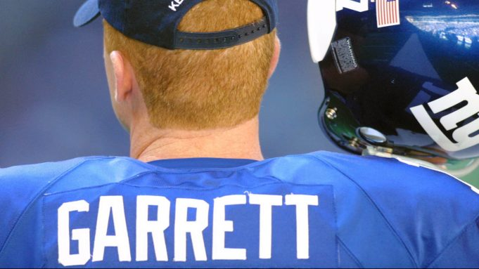 9 Dec 2001: Substitute quarterback Jason Garrett #17 of the New York Giants listens to the plays from the headset in his helmet during the game against the Dallas Cowboys at Texas Stadium in Irving, TX. The Cowboys won 20-13.