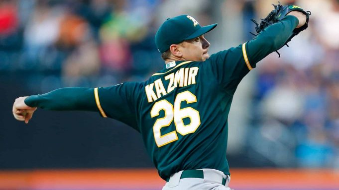 NEW YORK, NY - JUNE 24: Scott Kazmir #26 of the Oakland Athletics pitches in the first inning against the New York Mets at Citi Field on June 24, 2014 in the Flushing neighborhood of the Queens borough of New York City.