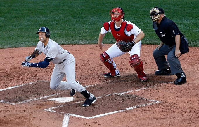 BOSTON, MA - SEPTEMBER 28: Derek Jeter #2 of the New York Yankees hits a single for his last career at bat in the third inning against the Boston Red Sox during the last game of the season at Fenway Park on September 28, 2014 in Boston, Massachusetts.
