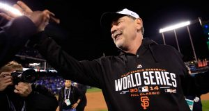 KANSAS CITY, MO - OCTOBER 29: Manager Bruce Bochy #15 of the San Francisco Giants celebrates on the field after defeating the Kansas City Royals 3-2 to win Game Seven of the 2014 World Series at Kauffman Stadium on October 29, 2014 in Kansas City, Missouri.